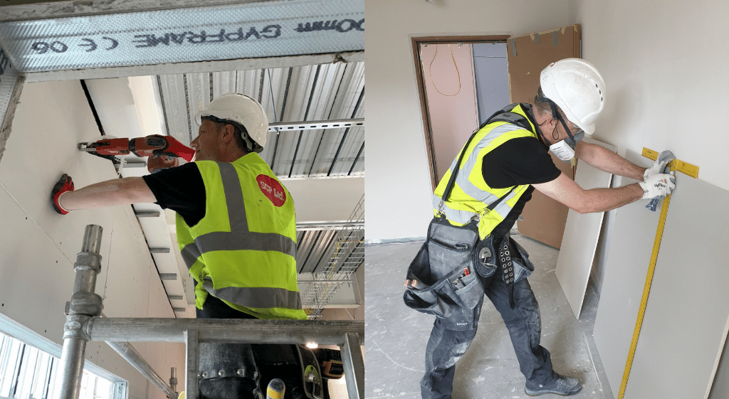 Dry liners measuring a plasterboard and fixing it to a wall during their NVQ Level 2 in Dry Lining
