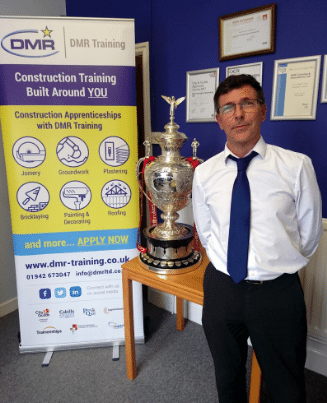 NVQ assessor Steve Graham posing with the Ladbrokes FA Cup