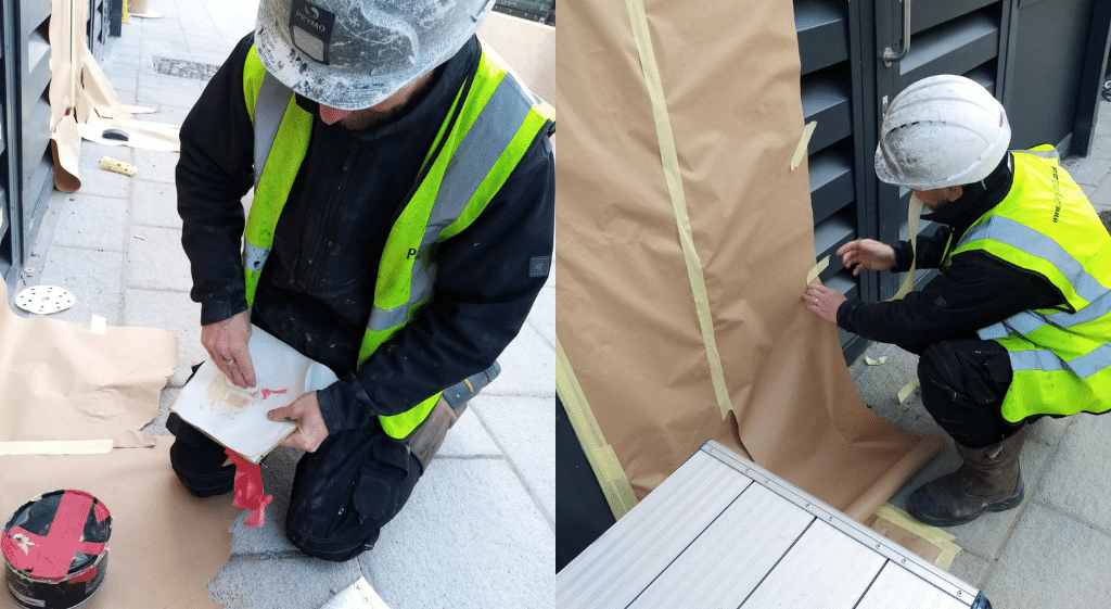 A damage repair worker carrying out repairs on the side of a building during his NVQ Level 2 in Damage Repair and Resurfacing
