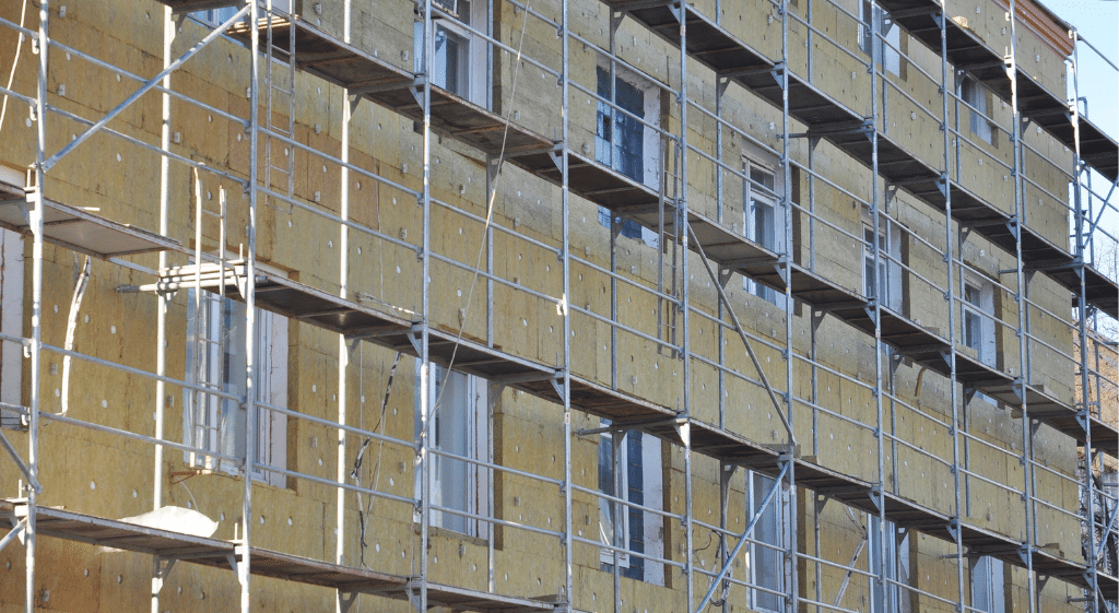 An office block external wall and scaffolding during installation of fibre glass insulation